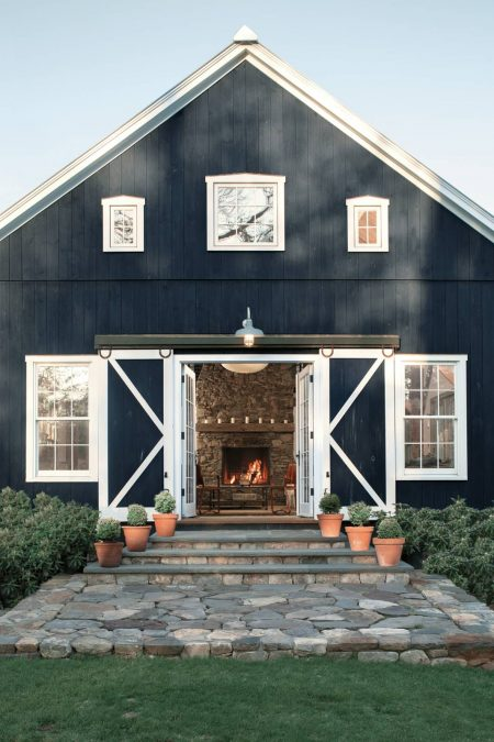 a hale navy blue benjamin moore barn styled front door in a rustic farmhouse property