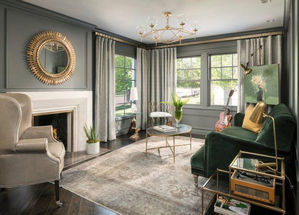 dark wood floor living room in gray + green combination and pop of gold