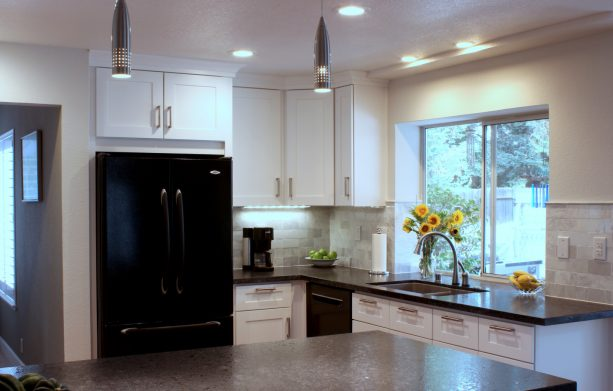 mid-sized transitional kitchen design combines black appliances and clear white cabinets