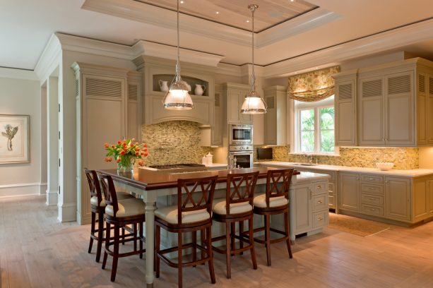 muted sage green cabinets in a l-shaped traditional kitchen