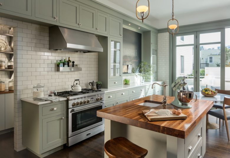 sweet victorian kitchen with sage green shaker cabinets and wood countertops