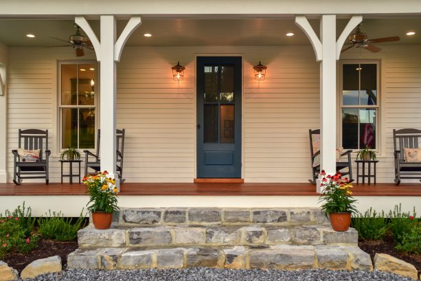 the combination of beige walls and a valspar mountain river dark blue front door