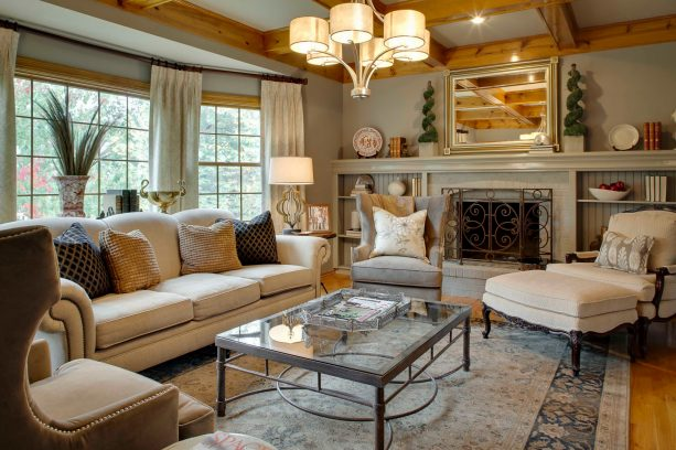traditional gray living room with a touch of gold color