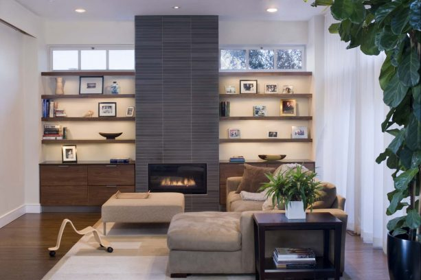 a custom-built walnut built-in shelves around a tile-wrapped fireplace