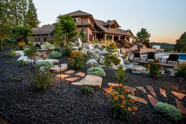 boulder stepping stones perched on a hillside slope landscape