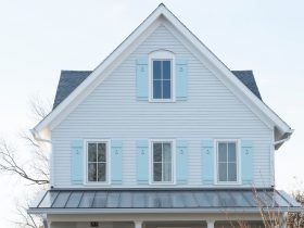 hardi-plank-arctic white home remodel with light blue window shutters