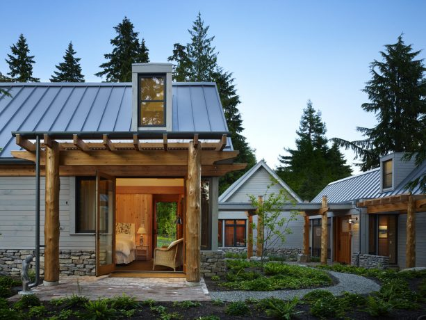mountain style pergola attached to a gable metal roof